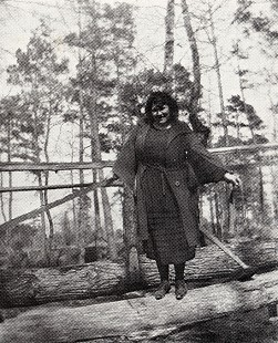 Leta Halbert on the foot log across Halbert Creek; Prattsville, Arkansas, 1921  © Pryor Center for Arkansas Oral and Visual History, University of Arkansas